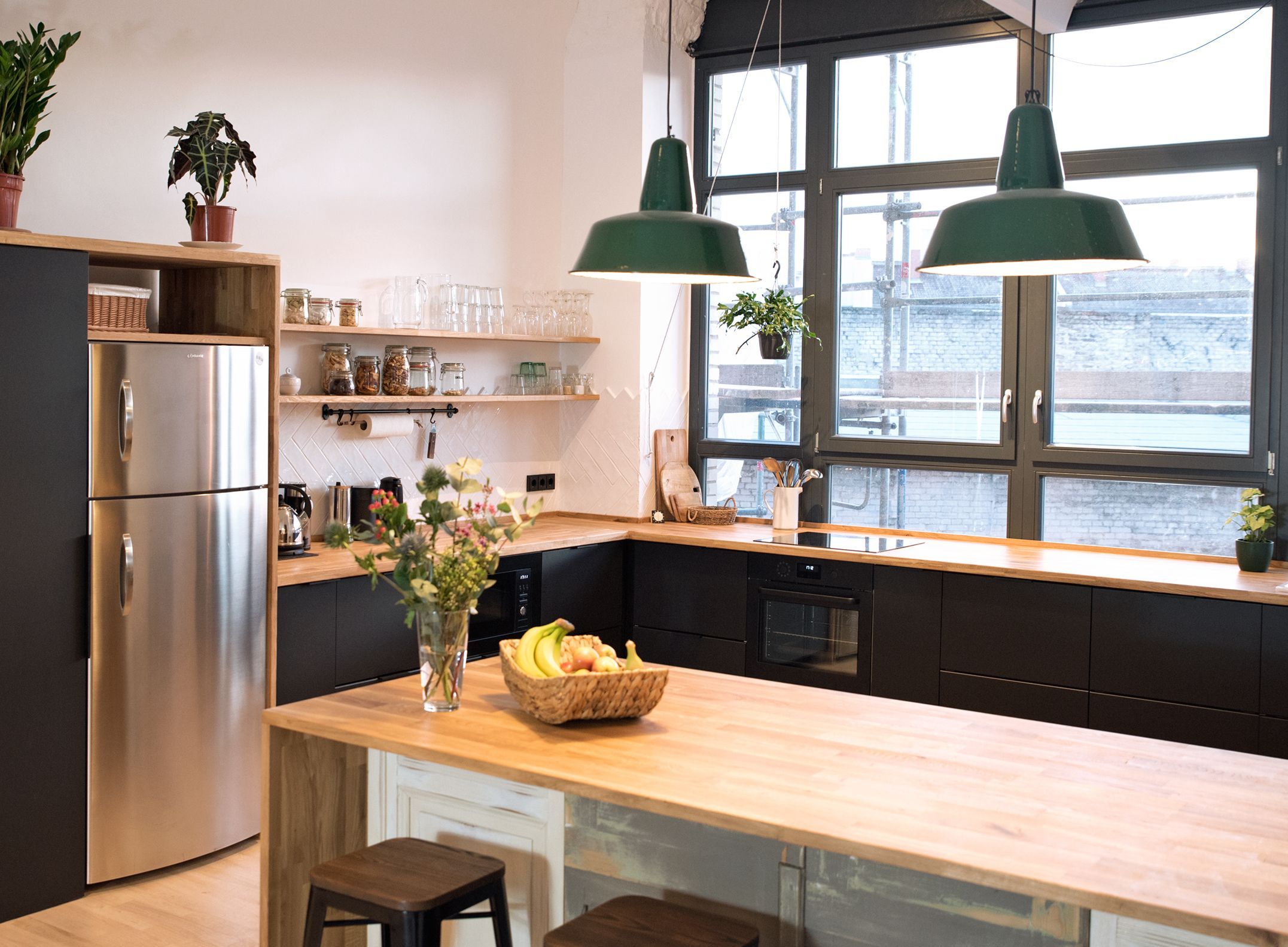 The cosy café style office kitchen with oak counters and industrial lamps