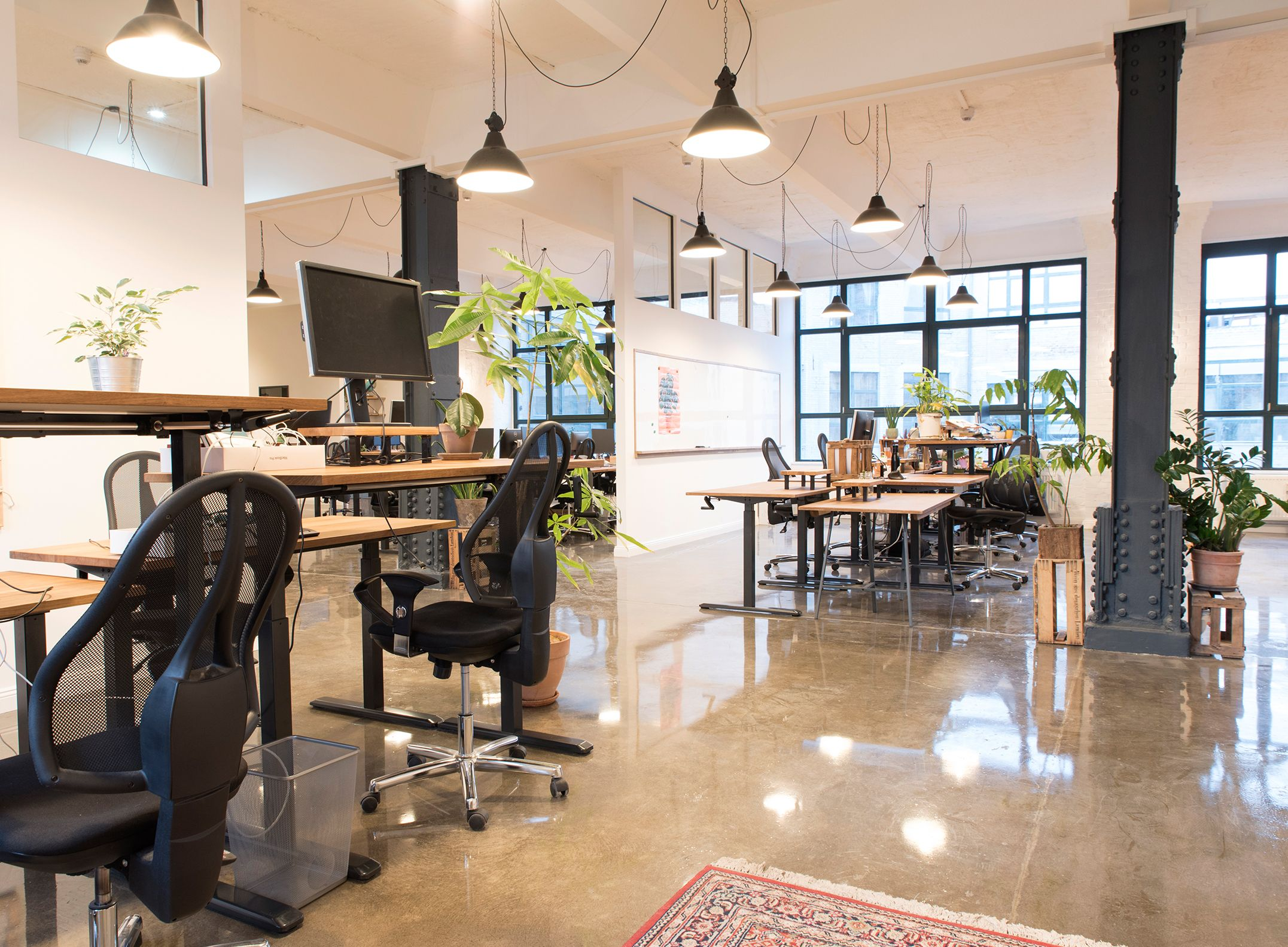 The office is large, spacious and bright with industrial design