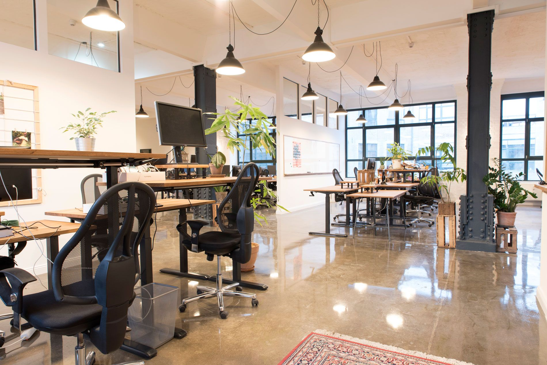 The bright spacious office is in a former factory building.